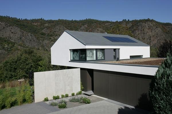 Dachdecker jansen langenfeld dachdeckermeister for Flachdachhaus mit garage